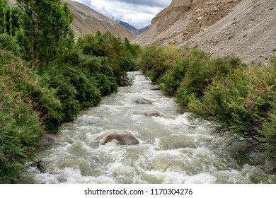 Canal in  Nubra Valley with Mountain behind, Ladakh, Jammu and Kashmir, India in July 2018