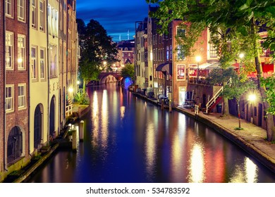 Canal Oudegracht in the night colorful illuminations in the blue hour, Utrecht, Netherlands. Used toning