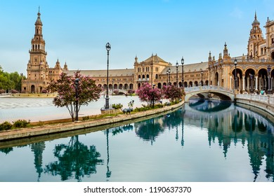The canal in the Plaza de Espana in Seville, Spain sweeps around towards the north tower in the early morning in summertime