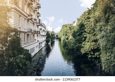 canal in residential neighborhood in Hamburg, Germany on sunny summer day