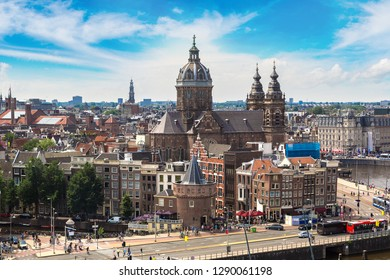 Canal and St. Nicolas Church in Amsterdam in a beautiful summer day, The Netherlands