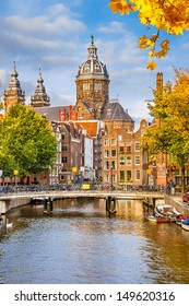 Canal and St. Nicolas Church in Amsterdam, the Netherlands