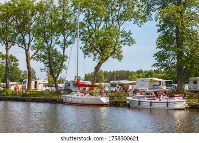 Göta canal, Sweden, July, 2016, Camping site with boats and caravans