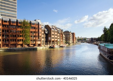 canal in town with houses and apartments. waterside in bristol in england