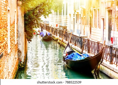 Canal with two gondolas in Venice, Italy. Architecture and landmarks of Venice. Summer sunny day in Venice.