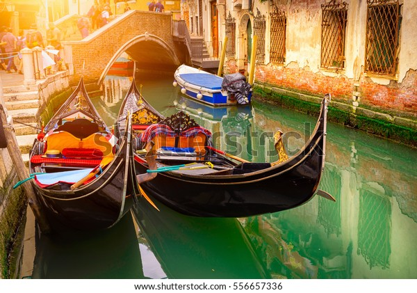 Canal with two gondolas in Venice, Italy. Architecture and landmarks of Venice. Venice postcard with Venice gondolas.