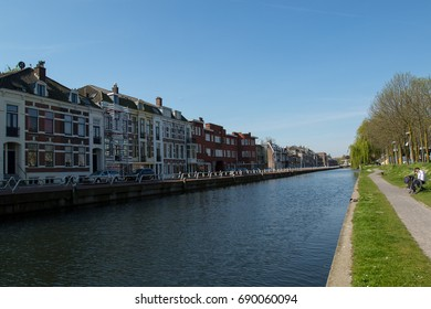Canal in Utrecht netherlands with the reflection of blue sky and buildings