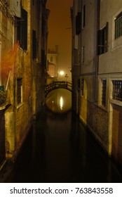 Canal in Venice (Italy) by night. bridge reflection in canal water. Long exposure