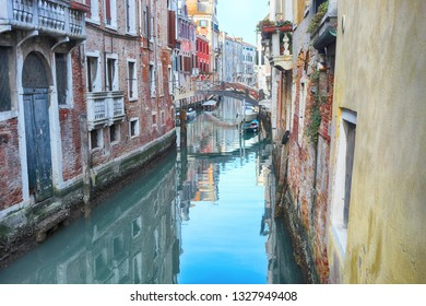 Canal in venice italy with small bridge