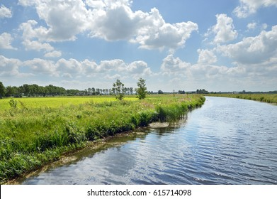 Canalised river and cloudy sky in a Dutch Landscape in the province of Drenthe, The Netherlands.
