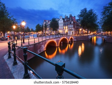 Canals of Amsterdam (Holland - Netherlands) at dusk.