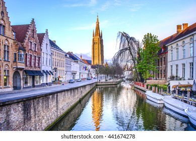 Canals of Bruges with the church of our lady in the background
