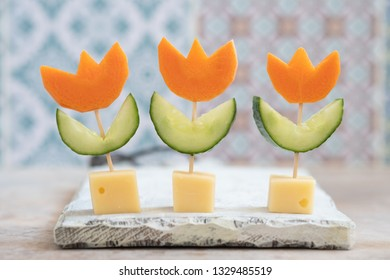 Canape flower with cucumber, carrot and cheese