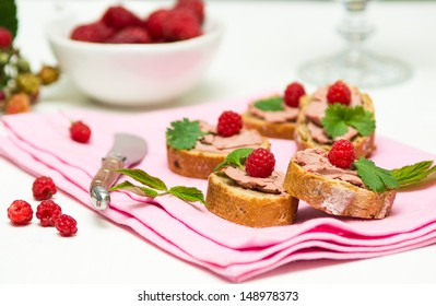 Canape with hand-made perigueux truffle paste ( pate) and raspberries