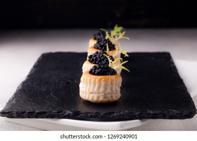 canape with salmon mousse and caviar