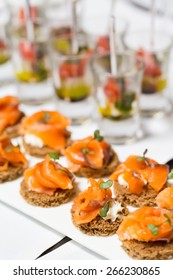 canape with salmon on a white plate,catering weddings table with