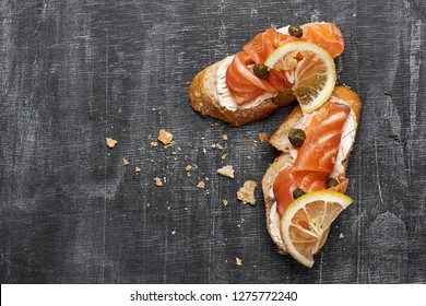 Canape with smoked salmon and cream cheese, selective focus, top view