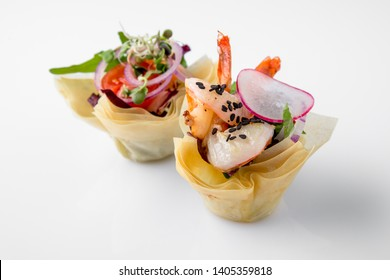Canape tartlet with shrimp and vegetables. Beautifully decorated catering banquet menu. Food snacks and appetizers for buffet. Isolated on white background
