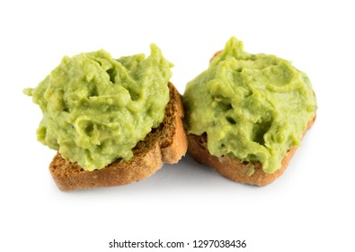 Canapes with bread and guacamole isolated on white background