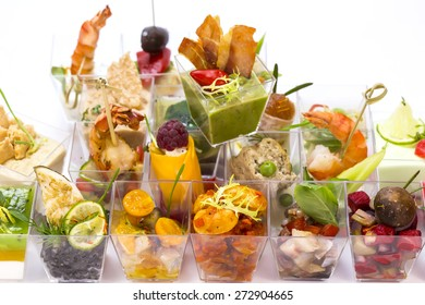 Canapes of cheese vegetables meat and seafood on white background