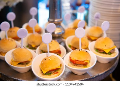 canapes mini cheese burger in event night party