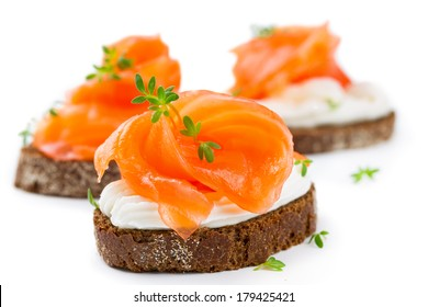 Canapes with salmon isolated on white background
