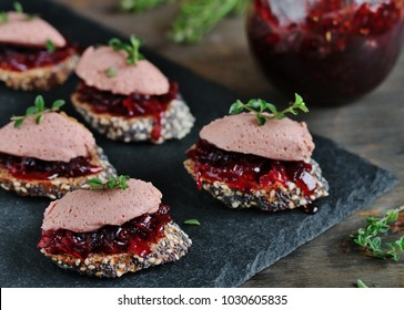 Canapes snacks with chicken pate and onion marmalade (chutney)