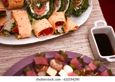 Canapes or tapas on toothpicks: cheese, olives, mushrooms, pickles. New year party food at Poland with barbecue sauce