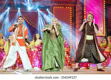 CANARY ISLAND, SPAIN - FEBRUARY 15, 2015:Television hosts Jose Carlos Campos (l), Alexia Rodriguez (m) and Victor Formoso (r) onstage during city of Las Palmas carnival Junior Queen Gala opening show.