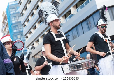 CANARY ISLAND, SPAIN - FEBRUARY 17, 2015: Unidentified men playing drums to samba rhythms in the streets during city of Las Palmas carnival in the sun.