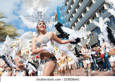 CANARY ISLAND, SPAIN - FEBRUARY 17, 2015: Unidentified women from Comparsa Yoruba dancing samba in the streets during city of Las Palmas carnival in the sun.