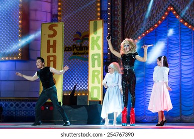 CANARY ISLAND, SPAIN - FEBRUARY 20, 2015: Drag Ikaro (m) as Olivia Newton John from the movie Grease and unidentified assistants with Grease costumes performing onstage during Drag Queen Gala.