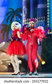 CANARY ISLAND, SPAIN - FEBRUARY 20, 2015: Los Quintana from Spain with red costumes singing onstage during city of Las Palmas carnival One Thousand and One Nights Drag Queen Gala.