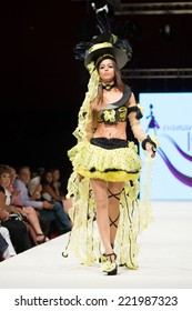 CANARY ISLANDS -26 SEPTEMBER: Unidentified model on the catwalk wearing carnival costume from  Eva Maria Ltg during Carnival Fashion World in Las Palmas September 26, 2014 in Canary Islands, Spain