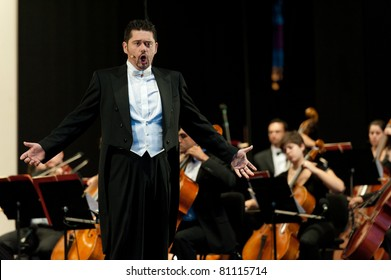 "CANARY ISLANDS - JULY 16: Tenor Manuel de Diego from Spain, singing ""Una voce poco fa"" from Donizetti, onstage during Festival of Music July 16, 2011 in Las Palmas, Canary Islands, Spain"