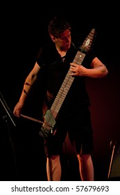 CANARY ISLANDS - JULY 22: Michael Bernier from NY with his Chapman Stick performing onstage at theater CICCA during Stick Mens touring in Europe July 22, 2010 in Canary Islands