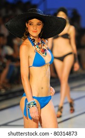 CANARY ISLANDS -JUNE 18: Aida Artiles walks the runway in the Vitamina C and Laja Picon collection during Moda Calida in Maspalomas on June 18, 2011 in Canary Islands, Spain