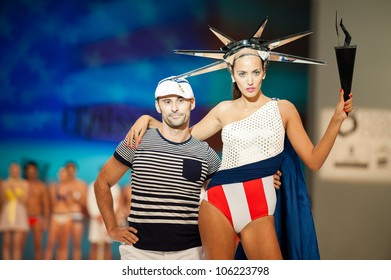 CANARY ISLANDS -JUNE 22: Designer Gabriel Macias(l) with unidentified models onstage in the Gabriel Croissier collection during Gran Canaria Moda Calida on June 22, 2012 in Canary Islands, Spain