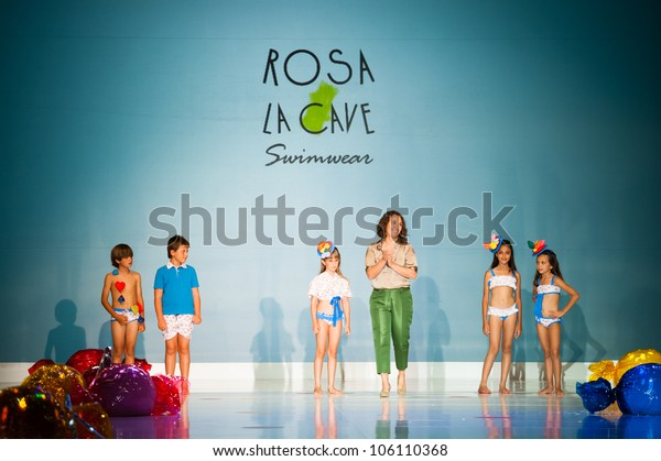 CANARY ISLANDS -JUNE 22: Designer Irene Campos Montesdeoca(m) with unidentified children onstage in the Rosa La Cave collection during Moda Calida on June 22, 2012 in Canary Islands, Spain