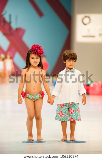 CANARY ISLANDS -JUNE 22: Unidentified models walks the runway in the Oh! Soleil collection during Gran Canaria Moda Calida swimwear fashion show on June 22, 2012 in Canary Islands, Spain
