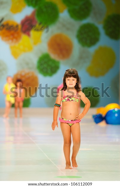 CANARY ISLANDS -JUNE 22: Unidentified models walks the runway in Dolores Cortes collection during Gran Canaria Moda Calida swimwear fashion show on June 22, 2012 in Canary Islands, Spain
