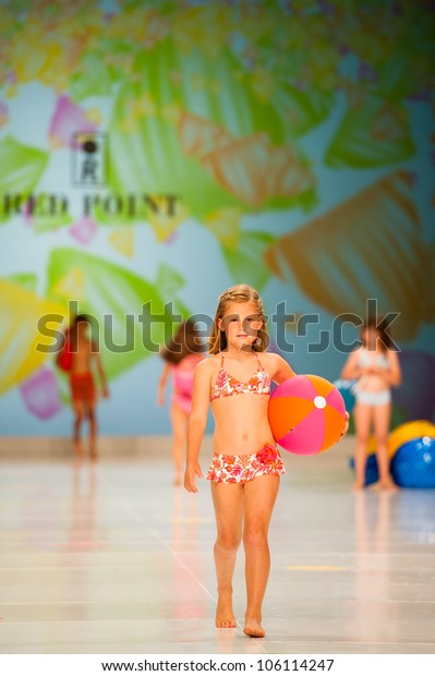 CANARY ISLANDS -JUNE 22: An unidentified model walks the runway in Red Point collection during Gran Canaria Moda Calida swimwear fashion show on June 22, 2012 in Canary Islands, Spain