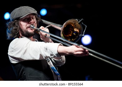CANARY ISLANDS – NOVEMBER 12: Matthew Benson from Ireland playing trombone onstage with Brassroots during Womad 2011 November 12, 2011 in Las Palmas, Canary islands, Spain