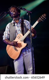 CANARY ISLANDS - NOVEMBER 13: Jazz Guitarist, singer and composer Muntu Valdo from Cameroon performs onstage during Womad in Las Palmas November 13, 2010 in Canary Islands, Spain