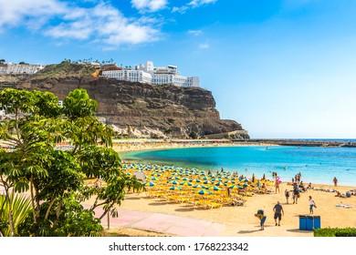 Canary Islands, Spain - December 12, 2018: Picturesque Amadores beach (Spanish: Playa del Amadores) near famous holiday resort Puerto Rico de Gran Canaria on Gran Canaria island, Spain