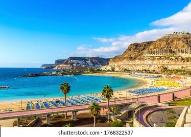 Canary Islands, Spain - December 12, 2018: Panorama of Amadores beach (Spanish: Playa del Amadores) near famous holiday resort Puerto Rico de Gran Canaria on Gran Canaria island, Spain