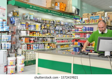 Canary islands, Spain - january 20, 2011: Operator behind the counter of an industrial hardware store in the north of the island of Tenerife