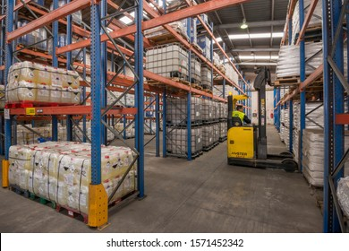 Canary islands, Spain - november 14, 2013: Operator working with a forklift inside a chemical store on the island of Tenerife