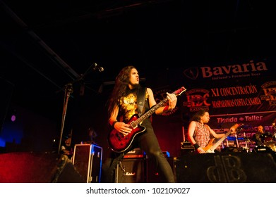 CANARY ISLANDS, SPAIN-MAY 5: Guitarist Alberto Marin(l) and Alvaro Tenorio(r) from Hamlet, from Madrid, perform during Harley Davidson MCs celebration on Mai 5, 2012 in Canary Islands, Spain
