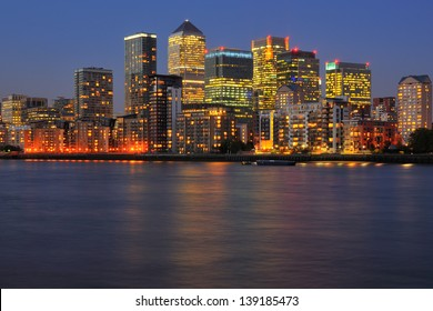 Canary Wharf business district, London UK at twilight